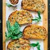 Cắt bánh mì thành nhiều khoanh mỏng. Phết đều hỗn hợp lên các lát bánh mì rồi cho vào lò nướng ở 250 độ C trong 10-15 phút là có thể thưởng thức.
