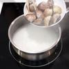 Cháo chín cho ngao vào, nấu thêm 10 phút. Nêm nếm lại theo khẩu vị gia đình nhé!