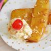 Cho thơm rim ra dĩa và thưởng thức kèm kem tươi nha. Cách làm thơm rim đường nâu cực kì đơn giản và dễ để bạn có ngay một món tráng miệng ngon khó cưỡng sau bữa cơm đấy.